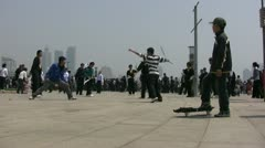 A boy watches a Kung fu performance in the city of Qingdao, China Stock Footage