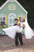 Boy and girl at pretend wedding Stock Photos