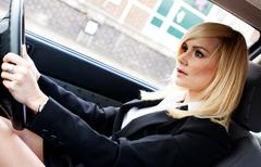 beautiful businesswoman driving a car - stock photo