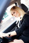 beautiful businesswoman driving a car - stock photo