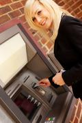 Woman and atm Stock Photos