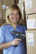 Female warehouse worker with barcode scanner Stock Photos