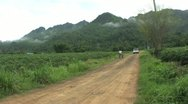 Boy Riding Bike Up Dirt Road Stock Footage