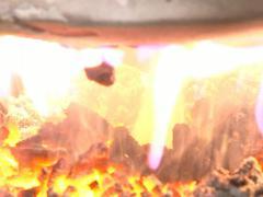 Burning straw pellet fire Stock Footage