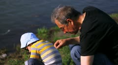 Man and boy near river Stock Footage