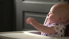 Baby being fed in her highchair Stock Footage