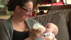 Mother feeding her baby Stock Footage