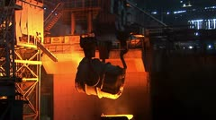 Iron and Steel Works. Pouring of molten iron Stock Footage
