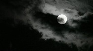Stock Video Footage of Super moon moving in and out clouds