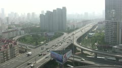 Highway skyline city smog traffic intersection pollution China Stock Footage