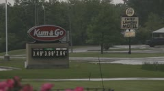 How to beat High Gas Prices - Irony as Horse and Buggy Pass Station Stock Footage