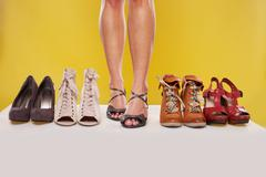 shapely legs and shoes on display - stock photo