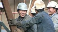 Stock Video Footage of Shipyard workers are laughing and look into the camera - China