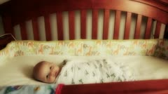 Newborn baby in crib Stock Footage