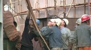 Stock Video Footage of China, labor, men, workers, lifting, metal, safety helmets, harbor, shipyard
