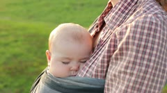 Baby sleeps in a sling (close-up) Stock Footage