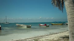 Fishing boats on the beach in isla mujeres mexico Stock Footage