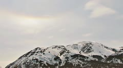Pearlescent Skies and Rainbow Cloud over Mountain Stock Footage