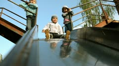 Children going down slide Stock Footage