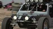 Stock Video Footage of Norra rally car passing