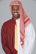 Middle eastern man wearing traditional dress and business attire Stock Photos