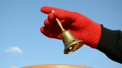 Hand with red glove and brass bell Stock Footage