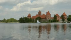Yacht on the lake near Lithuanian historical castle Trakai Stock Footage