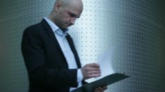 Young businessman working with documents - stock footage