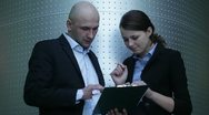 Young businessman and businesswoman working with documents Stock Footage