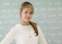 Young hispanic woman in front of blackboard Stock Photos