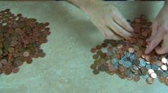 Seperating pennies Stock Footage