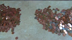 Stock Video Footage of time-lapse, separating coins on a counter-top