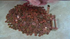 Rolling coins about $125 worth, time-lapse Stock Footage