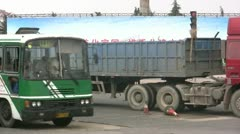 Heavy traffic drives past a Communist banner / slogan Stock Footage