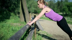 Young woman doing push-ups, exercising in the park HD - stock footage