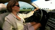 Woman driving wide profile Stock Footage
