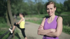 Portrait of young sporty woman in the park HD Stock Footage
