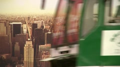 Chinese traffic drives past a billboard with the skyline of a US city on it Stock Footage