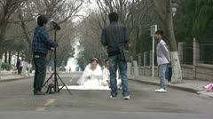 Chinese couple have their wedding pictures taken Stock Footage