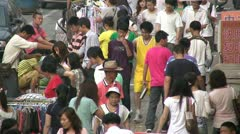 Students walking at a local market in Qingdao, China Stock Footage
