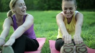 Portrait of two smiling women exercising in the park, tracking shot HD Stock Footage