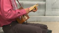 Music, man playing cigar box guitar, roots music Stock Footage