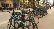Stock Video Footage of bike rack in the core of the city, wide