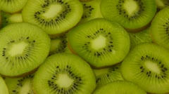 Slices of kiwi fruit closeup. Seamless loop. Stock Footage