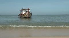 Small Boat Sailing Towards Beach Stock Footage