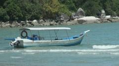 Little Blue Boat on Wavy Blue Sea - stock footage