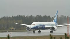 Boeing 787 Dreamliner take off in rainy weather Stock Footage