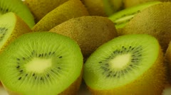 Halves an kiwi fruits closeup. Seamless loop. Stock Footage