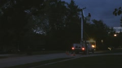 Stock - Utility Company working to repair power outage in the evening - Flashing Stock Footage
