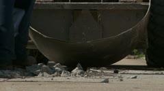 Worker picking up concrete debris on sidewalk Stock Footage
